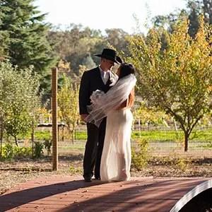 Couple embrace on bridge at Rough & Ready Vineyards Nevada County's Favorite Vineyard Wedding Venue