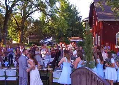 Outdoor wedding reception cheers as couple kiss at Rough & Ready Vineyards Nevada County's Favorite Vineyard Wedding Venue