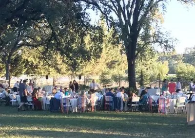 Rough and ready outdoor wedding reception early evening