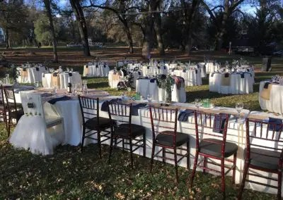 Outdoor wedding reception packages include guest tables