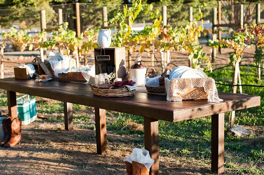 Outdoor wedding venue table set up overlooking vineyard