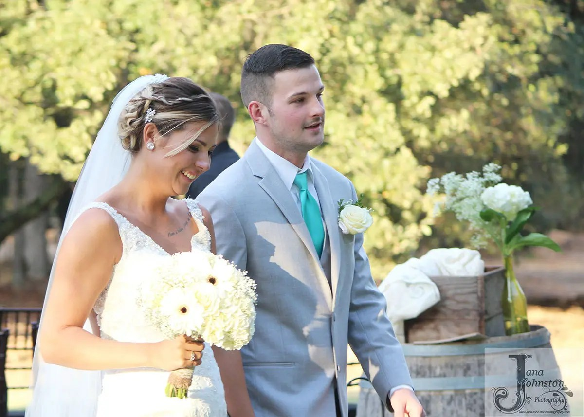 Happy couple married in outdoor wedding, be sure to hold the date for your vineyard wedding venue