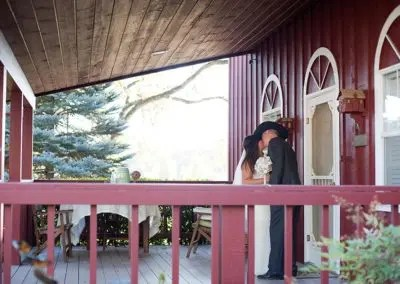 wedding kiss front porch Rough and Ready guest house