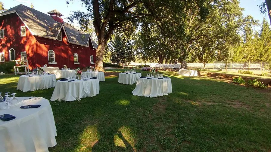 barn in background makes a lovely wedding venue setting
