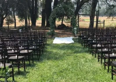Photo of an Intimate wedding set up under the oaks