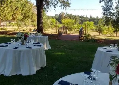 Garden wedding reception setting with bridge over creek at Rough and Ready Vineyards, the perfect location for weddings