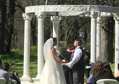 wedding couple getting married under the gazebo