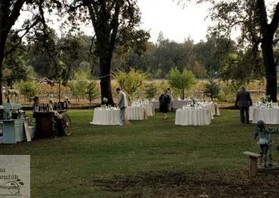 outdoor wedding reception being set up in a garden venue