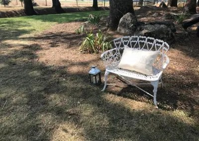 Love seat for him and her in woodland setting at Rough and Ready Vineyards