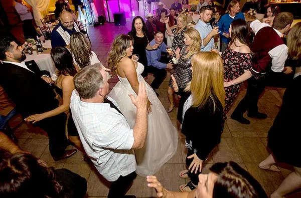 Wedding guests and bride having a good time on the dance floor