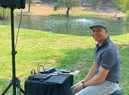 featured wedding DJ David Fullmer working at an outdoor wedding