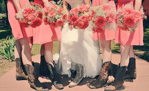 Four bridesmaids and the bride pose with their summer wedding bouquets