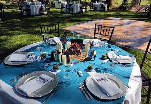 Themed guest tables at Josh and Bryna's adventure-themed wedding at Rough & Ready Vineyards
