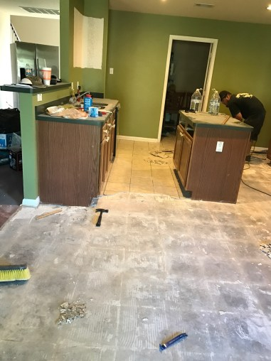 rustic farmhouse Kitchen before the wall color. The removal of the tile floors.