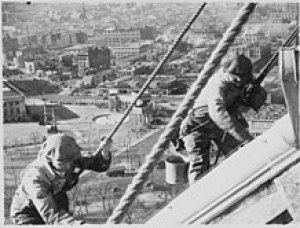 220px-Civil_Works_Administration_(CWA)_workmen_cleaning_and_painting_the_gold_dome_of_the_Denver_Capitol,_1934_-_NARA_-_541904