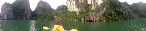 Kayaking in a lagoon - completely surrounded by the mountains except for a small cave you kayak through