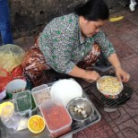 Vietnamese pancake-like snacks, this lady setup outside a school's yard for lunch hour
