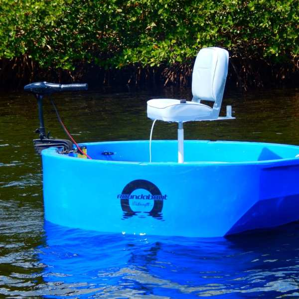 A blue round boat at the beach