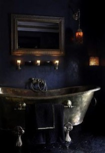 Dark moody bathroom designs that impress (11)