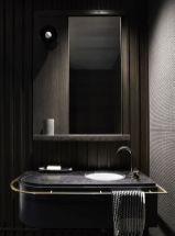 Dark moody bathroom designs that impress (16)