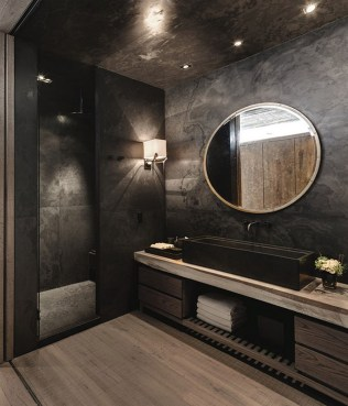 Dark moody bathroom designs that impress (6)