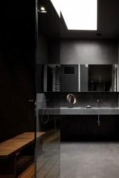 Dark moody bathroom designs that impress (9)