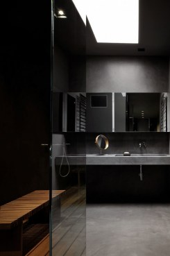 Dark moody bathroom designs that impress (9)