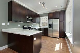 Stylish dark brown cabinets kitchen 63