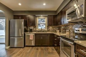 Stylish dark brown cabinets kitchen 68
