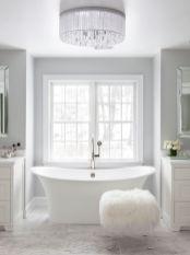 Stylish white subway tile bathroom 14