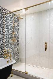 Stylish white subway tile bathroom 18