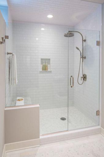 Stylish white subway tile bathroom 44