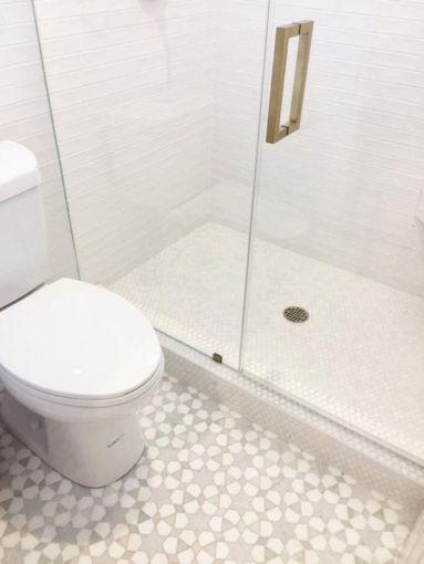 Stylish white subway tile bathroom 45