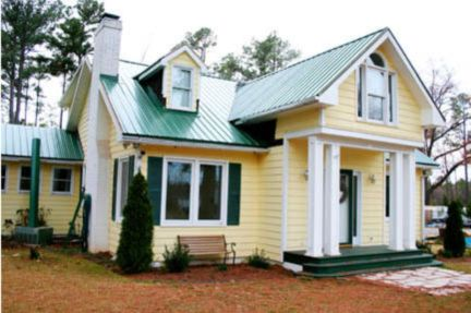 Exterior house colors with brown roof 34