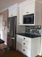 Inspiring black quartz kitchen countertops ideas 35