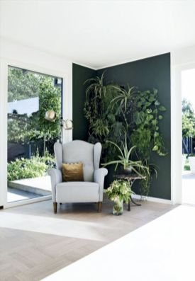 Stylish dark green walls in living room design ideas 33