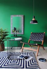 Stylish dark green walls in living room design ideas 35