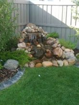Small backyard waterfall design ideas 18