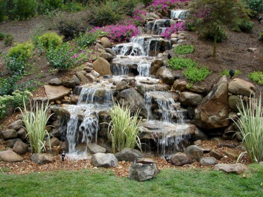 Small backyard waterfall design ideas 46