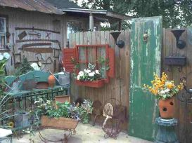 Brilliant garden junk repurposed ideas to create artistic landscaping 27