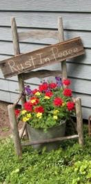 Brilliant garden junk repurposed ideas to create artistic landscaping 29