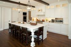 Cozy white kitchen with dark floors 02