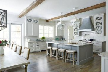 Cozy white kitchen with dark floors 08