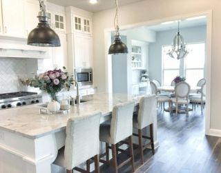 Cozy white kitchen with dark floors 09