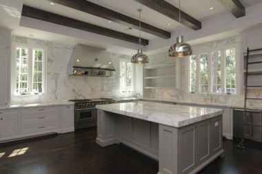 Cozy white kitchen with dark floors 12