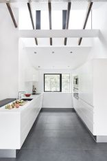 Cozy white kitchen with dark floors 14
