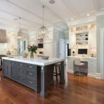 Cozy white kitchen with dark floors 16