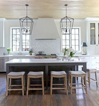 Cozy white kitchen with dark floors 17
