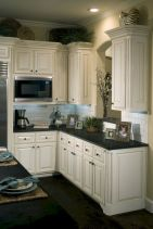 Cozy white kitchen with dark floors 29