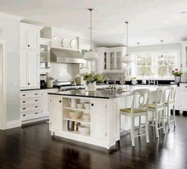 Cozy white kitchen with dark floors 31